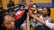 Philadelphia, Pennsylvania - December 13, 2016: The West Catholic girls basketball team come together before the start of the second half of their first home game. Pulse nightclub shooting victim Akyra Murray graduated from West Catholic just days before she was killed, and led her team to two district championships and scored over 1,000 points during her career at the school.  (Charles Mostoller for ESPN)