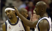 Washington Wizards' Michael Jordan, right, rubs teammate Richard Hamilton's head after Hamilton scored against the Sacramento Kings during the third quarter of the Wizards' 108-101 win, Thursday, Feb. 7, 2002, at the MCI Center in Washington. Hamilton led the Wizards with 33 points and Jordan had 25 points.(AP Photo/Nick Wass) ORG XMIT: MCI204